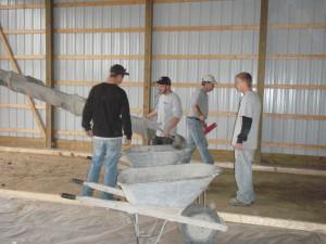 Pouring a pole barn floor.