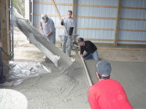 Pouring pole barn floor using 4500 psi concrete.